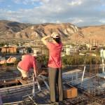 Joy on the roof in Onaville Haiti